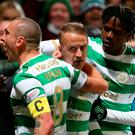 Celtic's Leigh Griffiths (centre) celebrates scoring his side's winner