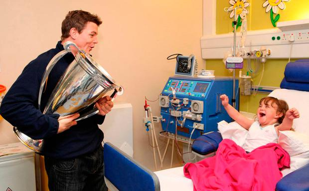 Michaela is overjoyed to see O'Driscoll with the European Cup in 2011. Photo: Fennells