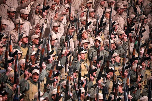 Kurdish fighters hold their weapons during a rally in Hasaka, north-eastern Syria, yesterday. Photo: Rodi Said/Reuters