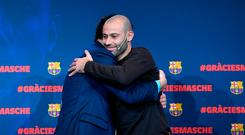 Barcelona FC president Josep Maria Bartomeu (L) hugs Barcelona's Argentinian defender Javier Mascherano during a farewell ceremony organised by the football club in Barcelona ahead of his transfer to China on January 24, 2018. Mascherano was unveiled as the latest big name to move to China, signing for Hebei China Fortune from Barcelona. / AFP PHOTO / LLUIS GENELLUIS GENE/AFP/Getty Images