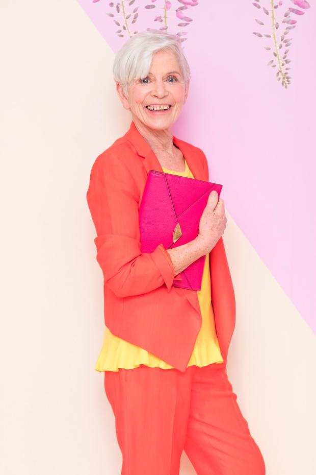 Model Lorna Britton at the launch of the Arnotts Spring/Summer '18 collection. She wears: Tara Jarmon coral blazer and trousers; Claudia Strater lemon knit; Michael Kors fuchsia envelope clutch bag and Vince Camuto stiletto heels. Picture: Anthony Woods