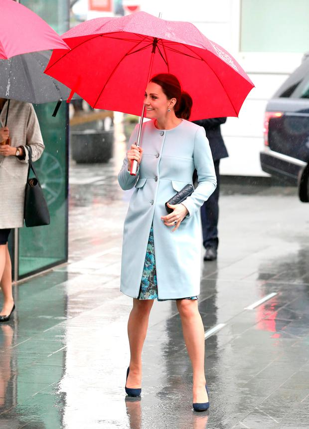 9c254bf5f50 Kate Middleton recycles €200 baby blue maternity coat for rainy day ...