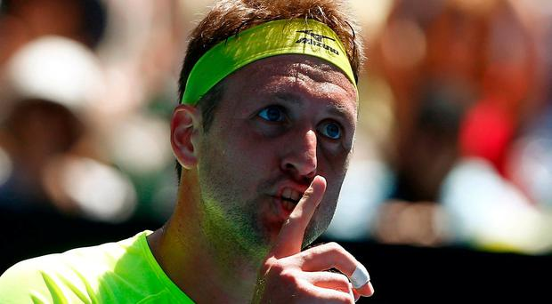 Tennys Sandgren of the U.S. reacts during his match against Chung Hyeon of South Korea. REUTERS/Thomas Peter