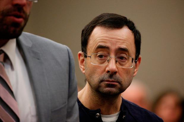 Larry Nassar, a former team USA Gymnastics doctor who pleaded guilty in November 2017 to sexual assault charges, stands with his legal team during his sentencing hearing in Lansing, Michigan, U.S., January 24, 2018. REUTERS/Brendan McDermid