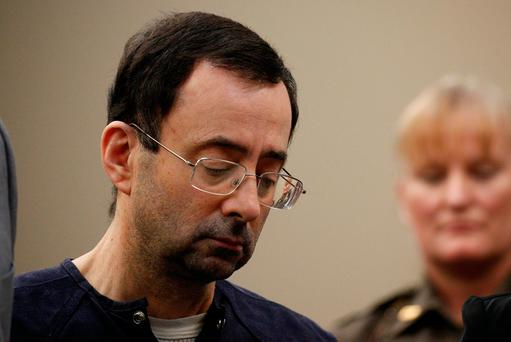 Larry Nassar, a former team USA Gymnastics doctor who pleaded guilty in November 2017 to sexual assault charges, stands during his sentencing hearing in Lansing, Michigan, U.S., January 24, 2018. REUTERS/Brendan McDermid