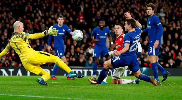 Granit Xhaka pokes the ball past goalkeeper Willy Caballero to seal Arsenal's place in the League Cup final. Photo: John Sibley/Action Images via Reuters