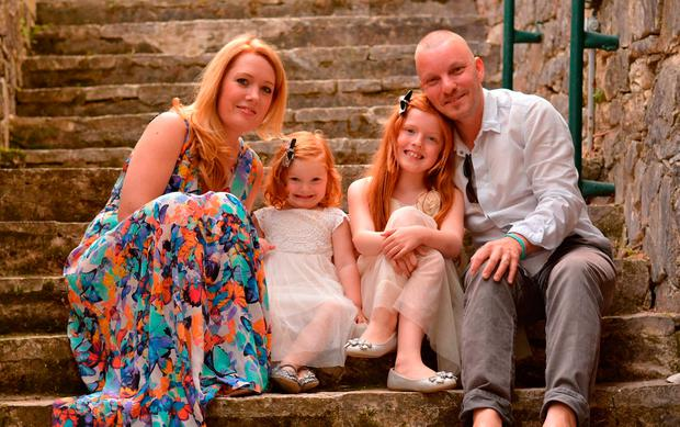 Undated handout video grab issued by Cancer Research UK of Steve Durrant, who was told he has a brain tumour and may only have ten years to live, with his wife Liza and their daughters Isobel, seven and Phoebe, three. Cancer Research UK/PA Wire
