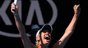 Denmark's Caroline Wozniacki celebrates after defeating Belgium's Elise Mertens