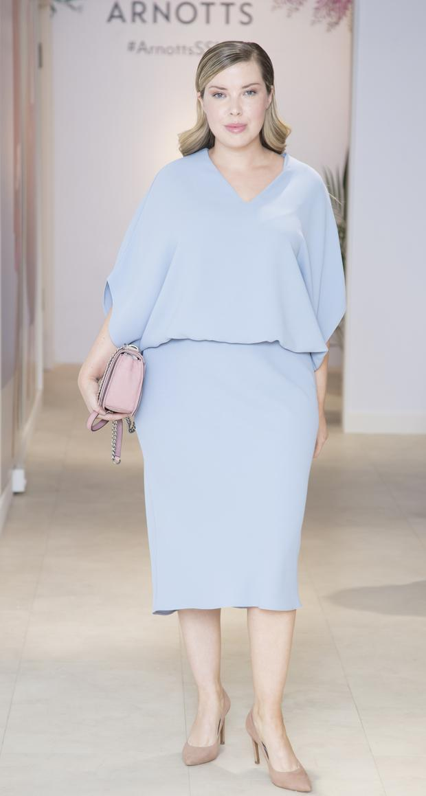 Seana Sweeney walking the Arnotts SS18 show wearing a Roisin Linnane dress