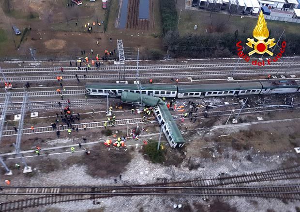 An aerial view shows a derailed train at the station of Pioltello Limito, on the outskirts of Milan, Italy, Thursday, Jan. 25, 2018. Carabinieri say a commuter train carrying hundreds of people has derailed in northern Italy, killing at least two people and seriously injuring at least 10. (Italian Firefighters Vigili del Fuoco via AP)