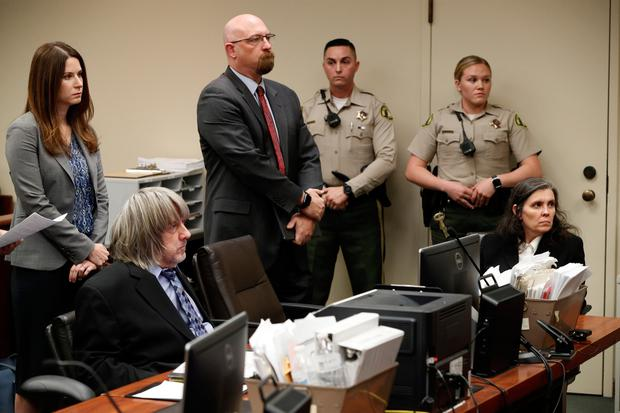 David Allen Turpin and Louise Anna Turpin appear in court with their attorneys in Riverside, Calif., Wednesday, Jan. 24, 2018. (Los Angeles Times/Gina Ferazzi via AP, Pool)