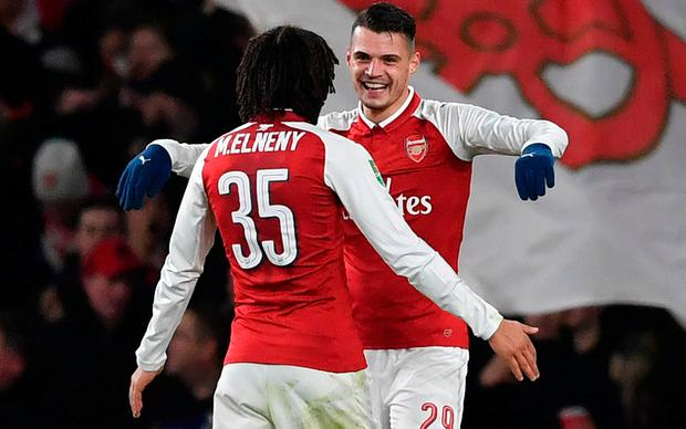 Arsenal's Granit Xhaka (R) celebrates scoring the team's second goal with Arsenal's Egyptian midfielder Mohamed Elneny