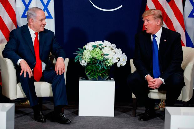 President Donald Trump meets with Israeli Prime Minister Benjamin Netanyahu at the World Economic Forum, Thursday, Jan. 25, 2018, in Davos. (AP Photo/Evan Vucci)