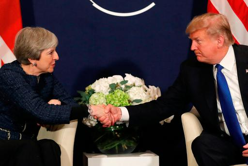 U.S. President Donald Trump shake hands with Britain's Prime Minister Theresa May during the World Economic Forum (WEF) annual meeting in Davos, Switzerland January 25, 2018 REUTERS/Carlos Barria