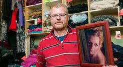 Richard Satchwell pictured at his home holding a photo of wife Tina