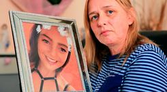 Jackie, mother of Nicole Fox Fenton (21), holds a picture of her daughter who took her own life after being the target of bullies. Photo: Gerry Mooney