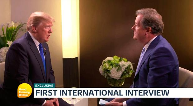 Video grab taken from ITV of US President Donald Trump (left) being interviewed by ITV's Good Morning Britain presenter Piers Morgan. PRESS ASSOCIATION Photo.