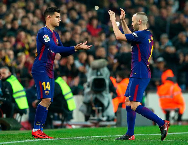 Barcelona's Philippe Coutinho comes on as a substitute to replace Andres Iniesta