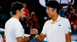 South Korea's Chung Hyeon shakes hands with Switzerland's Roger Federer