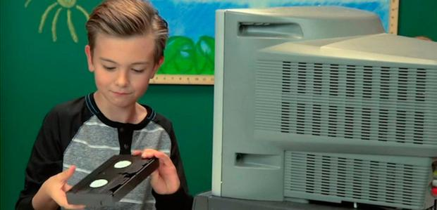 A child tries to figure out what a VHS tape is