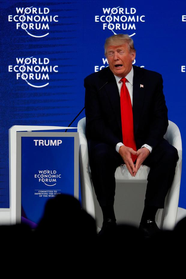 US President Donald Trump talks with Klaus Schwab, Founder and Executive Chairman of the WEF (unseen) during the World Economic Forum (WEF) annual meeting in Davos, Switzerland January 26, 2018. REUTERS/Carlos Barria
