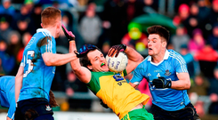 Michael Murphy runs into Dublin traffic in the league last year, as he's tackled by Eric Lowndes. The Donegal man acknowledges that they will have to alter their approach to have any chance of matching the Dubs. Photo: Philip Fitzpatrick/Sportsfile