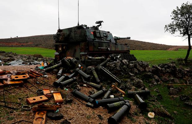 Empty shells are seen next to a Turkish army howitzer on the Turkish-Syrian border in Hatay province, Turkey. Photo: Reuters