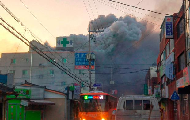 Heavy grey smoke rises into the air from a fire at a hospital in South Korea. Photo: Getty Images