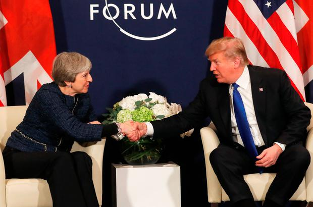 Mr Trump shakes hands with British Prime Minister Theresa May Photo: REUTERS/Carlos Barria