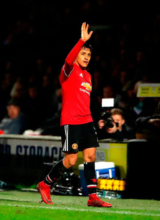 Manchester United's Alexis Sanchez acknowledges the fans