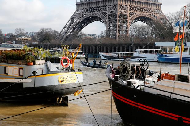 Paris police navigate on the Seine River that overflowed its banks as heavy rains throughout the country have caused flooding, in Paris, France, January 26, 2018. REUTERS/Pascal Rossignol