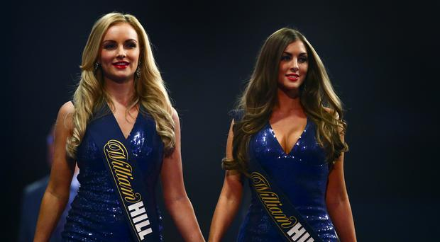 LONDON, ENGLAND: The oche girls walk off the stage, but they will not be used in the future. (Photo by Jordan Mansfield/Getty Images)