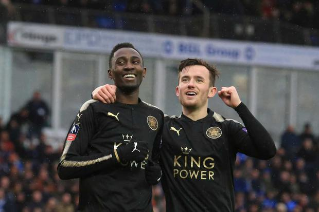 Leicester City's Nigerian midfielder Wilfred Ndidi (L) celebrates scoring their fifth goal during at Peterborough. / AFP PHOTO / Lindsey PARNABY