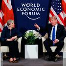 President Donald Trump with British Prime Minister Theresa May at the World Economic Forum in Davos. In different ways, both have experienced the volatility of voters and the unpredictability of financial markets. Photo: AP/Vucci