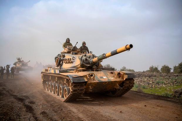 Moving in: Turkish army tanks last week entering Afrin, an enclave in northern Syria controlled by US-allied Kurdish fighters. Photo: AP