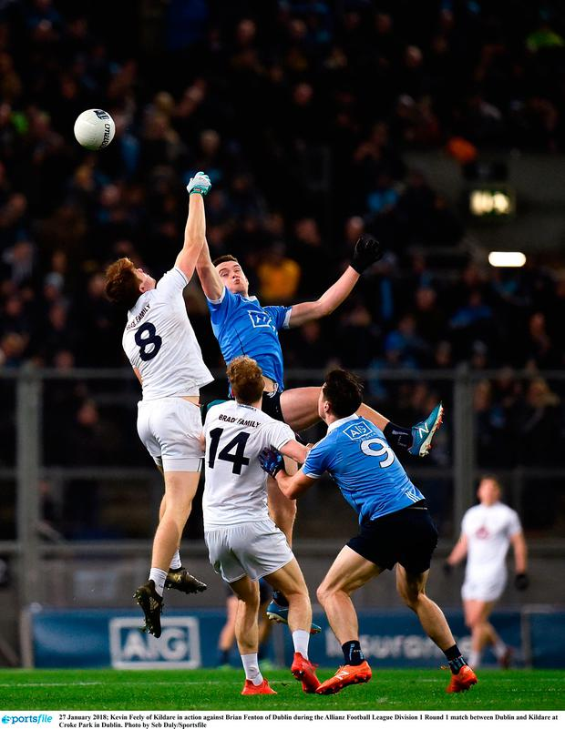 Kevin Feely of Kildare in action against Brian Fenton of Dublin