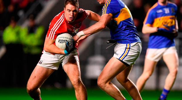 Colm O'Neill of Cork in action against Liam Casey of Tipperary
