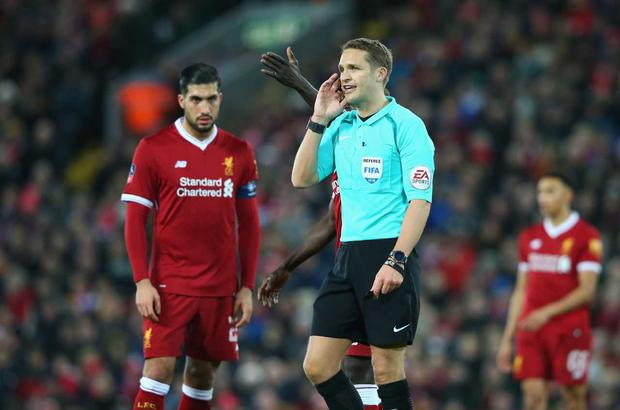 Referee, Craig Pawson makes a decision via VAR during The Emirates FA Cup Fourth Round match between Liverpool and West Bromwich Albion at Anfield on January 27, 2018 in Liverpool, England. (Photo by Alex Livesey/Getty Images)