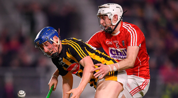 Kilkenny's John Donnelly tries to gather the ball under pressure from Tim O'Mahony of Cork. Photo: Sportsfile