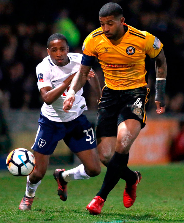 Tottenham Hotspur's Kyle Walker-Peters (left) and Newport County's Joss Labadie battle for the ball during their FA Cup, fourth round match. Photo: Andrew Matthews/PA