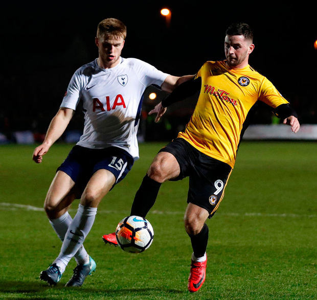 Newport County's Padraig Amond in action with Tottenham's Eric Dier. Photo: Matthew Childs/Reuters