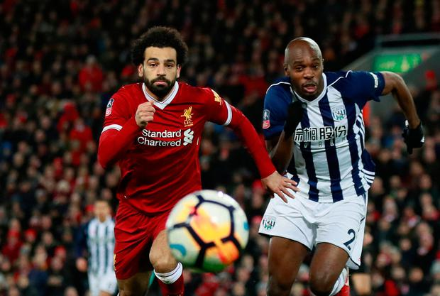 Liverpool's Mohamed Salah races against West Brom's Allan Nyom. Photo: Reuters/Jason Cairnduff