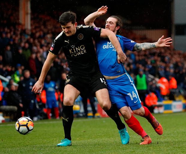 Peterborough's Jack Marriott tussels with Leicester City's Harry Maguire. Photo: John Sibley/Reuters