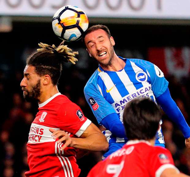 Brighton's Glenn Murray (right) and Middlesbrough's Ryan Shotton battle for the ball in the air during their FA Cup clash. Photo: Owen Humphreys/PA