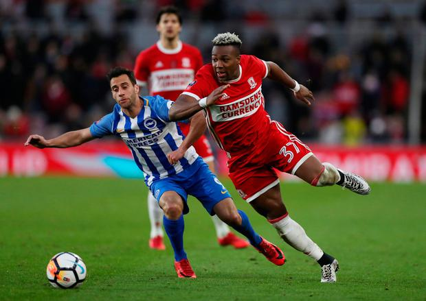 Middlesbrough's Adama Traore battles with Brighton's Sam Baldock. Photo: Scott Heppell/Reuters