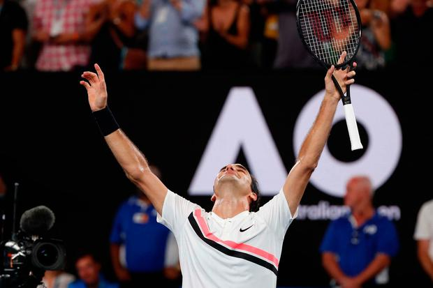 Switzerland's Roger Federer celebrates winning the final against Croatia's Marin Cilic