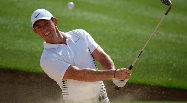 Ireland's Rory McIlroy plays a bunker on the 2nd hole