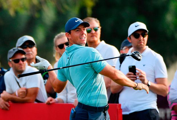 Rory McIlroy lets go of his driver as he tees off on the 16th hole