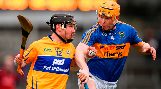 David Reidy of Clare in action against Donagh Maher of Tipperary