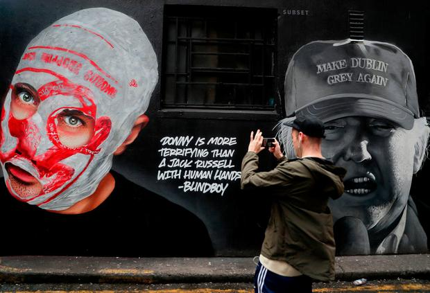 A new mural by art group Subset of Blindboy Boatclub, one half of Irish comedy hip hop group 'The Rubberbandits' along with a quote referencing US President Donald Trump, in Dublin's city centre. Brian Lawless/PA Wire